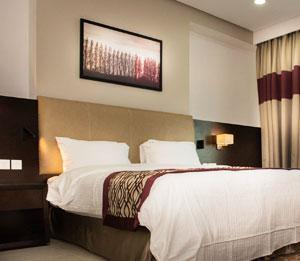 شقق كبيرة للعوائل في فندق وأجنحة رامادا في جزر أمواج